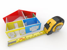 Measure tape and abstract three-dimensional  house Stock Photo