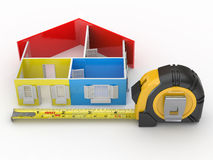 Measure tape and abstract three-dimensional  house Stock Photos