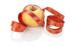 Measure tape and apple Royalty Free Stock Image