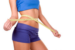 Measure tape around slim beautiful waist Stock Photography