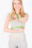 Measure tape around woman's waist Stock Photo