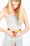 Measure tape around woman's waist Stock Image