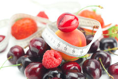 Measure tape and berries Royalty Free Stock Photography