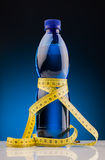 Measure tape  and bottle of water Royalty Free Stock Photography