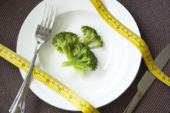 Measure tape on broccoli dish Stock Photography