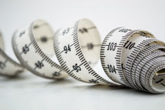 Measure tape or centimeter isolated over white Stock Photography