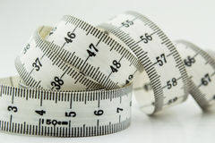 Measure tape or centimeter isolated over white Royalty Free Stock Photos