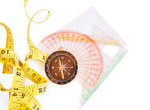 Measure Tape, Compass, ruler on white background Stock Image