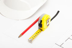Measure tape, construction helmet and pencil Stock Photography