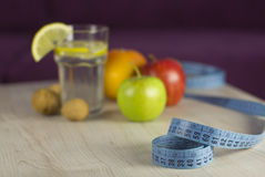 Measure tape with diet food Royalty Free Stock Image