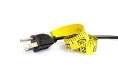 Measure tape and electric plug Royalty Free Stock Photo