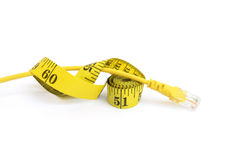Measure tape and Ethernet cable Royalty Free Stock Images