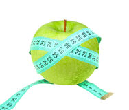 Measure tape on green apple Royalty Free Stock Photo