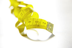 Measure tape. Isolated over white. Stock Images