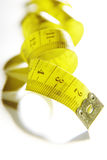 Measure tape. Isolated over white. Stock Photos