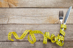 Measure tape with knife and fork. Diet food Stock Images