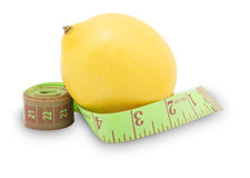 Measure tape and lemon, diet concept. Measure tape and a lemon, diet concept stock photos