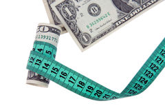 Measure tape with money Royalty Free Stock Photos