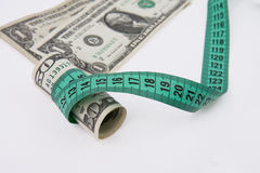 Measure tape with money Royalty Free Stock Photo