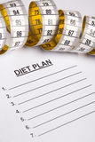 Measure tape on paper with diet plan Stock Photo