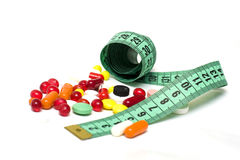 Measure tape with pills stock photo