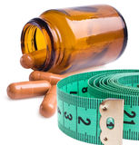 Measure tape with pills Royalty Free Stock Photos