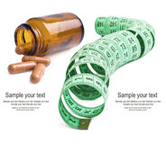 Measure tape with pills Stock Images