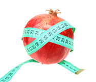 Measure tape on red pomegranate Stock Images