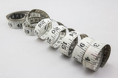 Measure Tape Rolling in Circle. Measure Tape Is Rolling in Circle Royalty Free Stock Photos