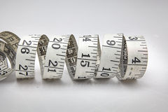 Measure Tape Rolling in Circle. Measure Tape Is Rolling in Circle. Show its measurement number Stock Image