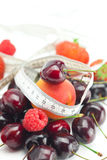 Measure tape,strawberry, cherry and raspberry Stock Image