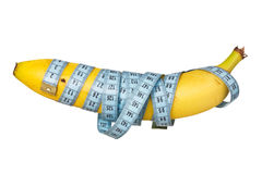 Measure tape wrapped on banana Stock Image