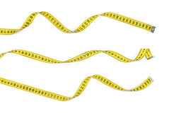 Measure tapes in different positions i Stock Photos