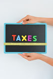Measure taxes concept in a business, company or economy royalty free stock image