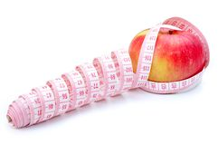 Measure tools around red apple Royalty Free Stock Photography