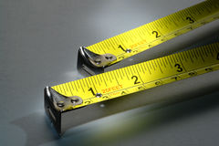 Measure Twice and Cut Once with Two Tape Mesures Stock Photo