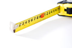 Measure up. Tape measure over architectural plans and red pencil (focus at the middle of scale Stock Image