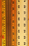 Measure up. Close up of various rulers stock photos