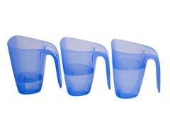 Measure volumen. Three plastic recipients with liquid Royalty Free Stock Photo