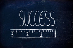 Measure your success. Humour design of a ruler measuring success Royalty Free Stock Photo
