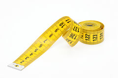 Measured tape of yellow color Royalty Free Stock Photos