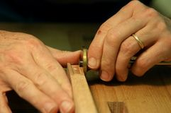 Measurement. Close-up of woodworker's hands making a precise measurement Royalty Free Stock Photos
