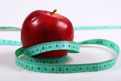 Measurement and apple Royalty Free Stock Photos