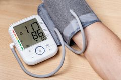 Measurement of blood pressure in a man. Stock Image