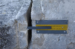 Measurement of a crack in a rock Stock Photo