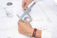Measurement of details. Quality assurance of the made details in mechanical engineering Royalty Free Stock Photo
