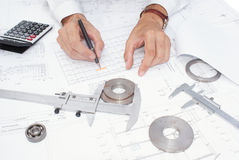 Measurement of details. Quality assurance of the made details in mechanical engineering Stock Photography
