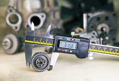 Measurement of the details by a digital caliper.  stock images