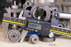 Measurement of the details by a digital caliper.  stock photos