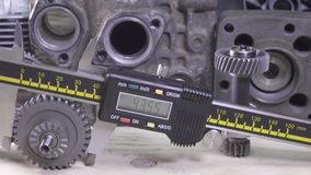 Measurement of the details by a digital caliper, Dolly shot stock video footage